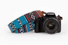 Portland Camera Strap - Carry your camera in comfort and style with this woven northwest style camera strap. ($29.00, http://photojojo.com/store)