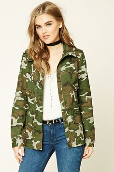 A woven jacket featuring a camo print, mock neck, zipper and button front, a zipper chest pocket, two button flap pockets, an elasticized drawstring waist, and long sleeves.