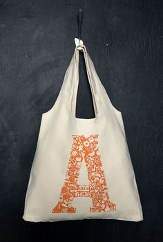 This durable, casual bag is manufactured totally in Greece.Original artwork created and hand screened by typokomio.The artwork illustrates all the things you can enjoy in Athens.100% cotton heavy canvas.43cm (w) x 42cm (h), 23cm straps.                   225gr weight approx.Orange print on natural.Cleaning Instructions:Hand wash or machine wash on the gentle cycle with cold water (to avoid shrinking).Wash inside out and do not use dryer (to avoid damaging...