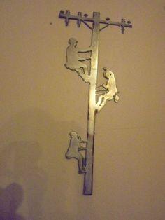 Three Lineman wall art  $45.00 (2 1/2' tall)  www.CrookedRiverMetalArt.com Lineman Wife, Power Lineman, Welding Art Projects, Metal Projects, Wood Walker, Garage Art, Scrap Metal Art, Metal Artwork, Wooden Crafts