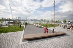 Long and skinny rectilinear pavers with clean lines.  Nice mix of grey tones.  The Edge Park in Brooklyn by W Architecture & Landscape Architecture. (www.w-architecture.com)