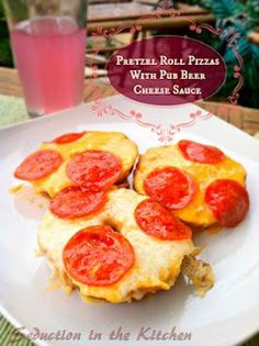 Pretzel Roll Pizzas with Pub Beer Cheese Sauce. Access to the PR recipe too. Easy, and with LOTS of toppings, this makes a good 'pizza appetizer' for football.  ~