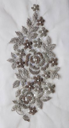 Hand-made motif with wire embroidery flowers and silver metallic leaves