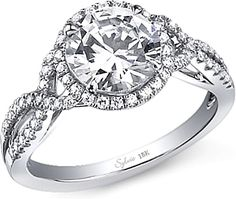 Sylvie Twist Shank Halo Diamond Engagement Ring  : This diamond engagement ring setting by Sylvie features round brilliant cut diamonds along a twist shank as well as around the center stone of your choice.