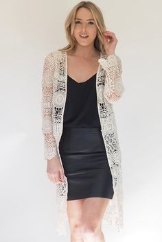 This Crochet kimono is calling to be worn at all the hottest summer music festivals! This long sleeve, long line kimono made from cream crochet cotton is one size only, can fit size 6-12.