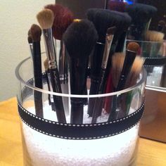 Homemade Makeup brush holder.  Tired of always looking for my brushed in the morning...so I you tubed brush containers n this is what I found- Glass jar from TJMax , ribbon,all purpose glue and flower pot beads(could only find at Michaels) and walla. Caibrynn has so far not noticed it on my vanity.