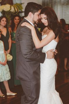 First dance in Pronovias Ombera dress in Ivory. The groom is in Vera Wang's Grey Tux.
