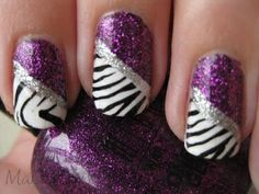Glittery purple, silver with black and white tiger striped diagonal French tips