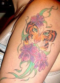 Vibrant tiger butterfly tattoos on bodies this tiger for Tiger face in butterfly tattoo