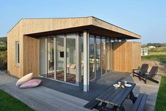 Using Corner Folding Glass Doors Makes this Compact Design a Real Vacation House