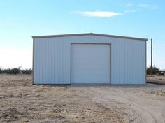 40 x 60 Metal building on 2.01 acres. Well and septic included in price. Building has 16' side walls and a 14' insulated overhead door. 100 amp electric panel with 8 4' lights. Vinyl backed insulation in building. No restrictions for usage.