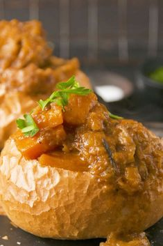 Curry in a bun - a slight variation on SA's iconic BUNNY CHOW dish Lamb Recipes, Dinner Recipes, South African Recipes, Ethnic Recipes, Curry Bread, Curry Bowl, Lamb Curry, Good Food, Yummy Food