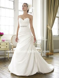 MoonlightBridal.com style J6255: This fitted satin mermaid features structured curve enhancing pleats and a soft bubble hem. A beaded sash finishes the look.