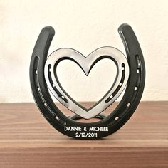Engraved (included) 6th anniversary 2012, standing horseshoe & heart, IN STOCK 1 or 2 lines for engraved names & date. Made in America. Recent feedback: Its both rustic and clean at the same time....This will make an excellent iron anniversary gift. One more happy customer: Just