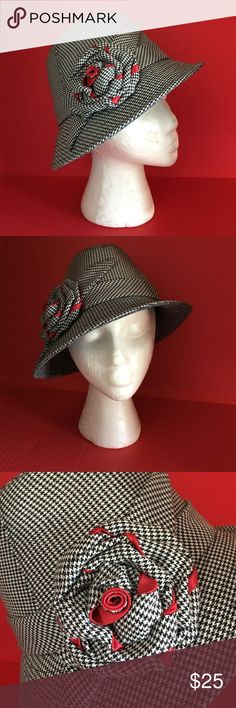 """GLAM HOUNDSTOOTH FEDORA🍒HOT🍒 The fedora is a style classic and this fedora is one of my favorites! Classic black and white houndstooth with a beautiful floral detail on the side, making it super chic and fun🍒Made by San Diego Hat Company, it is in unworn, new condition and would amp up any outfit! Inner circumference is approx. 21"""". It fits me and I wear a large in hats. Happy Poshing and thanks for checking out my closet🍒 San Diego Hat Company Accessories Hats"""