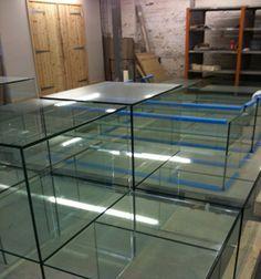 UV Bonded frameless glass fixtures for showcases in choice of glass, edgework and finish. #customlaminatedglass #digitallyprintedglass