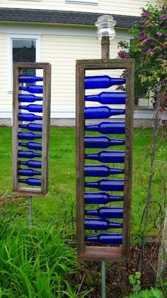 Different form of bottle tree. Great blue accents for garden or on backside of garage