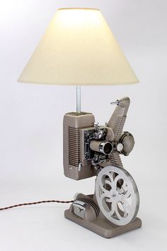 Vintage 1940s Revere Model 48, 16 Movie Projector Lamp -- perfect for home theater or conversation piece. Free Shipping! by RetroPickers on Etsy https://www.etsy.com/listing/216642030/vintage-1940s-revere-model-48-16-movie
