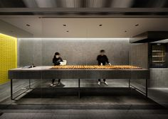 Japanese designer Yota Kakuda used a bespoke aluminium tile to cover the walls and floors in this shop that sells baked cheese tarts