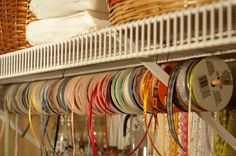 ribbon storage on a dowel tied up with cable ties.  easy and organized.  finally!