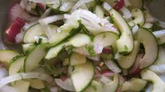 Cucumber salad with candy onions, red onions served with a cilantro lime yogurt dressing.
