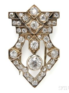 Art Deco 14kt White Gold and Diamond Clip Brooch, set with old European- and old mine-cut diamonds, approx. total wt. 2.32 cts., lg. 1 1/4 in.