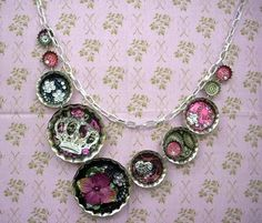 Mod Podge Dimensional Magic bottlecap necklace - i like simple jewelry so maybe just the one with the crown...very pretty