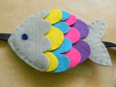 Fish Headband 2019 This design is loosely inspired by the classic childrens book The Rainbow Fish. The fish is hand-stitched by me and cut out of eco-felt and wool felt from my own pattern. The post Fish Headband 2019 appeared first on Wool Diy. Felt Crafts Diy, Sewing Crafts, Sewing Projects, Craft Projects, Crafts For Kids, Felt Christmas Ornaments, Christmas Crafts, Felt Fish, Felt Headband