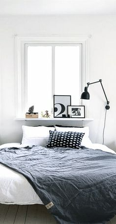 Bed in a tine room & old window // Via NordicDays.nl | BlackBird Styling in Göteborg