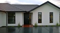 Celcrete exterior plaster finish with an Ebony Corona Shake roof.