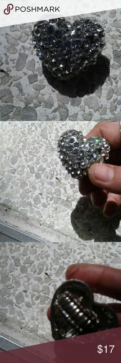 Sparkling heart silver ring Georgous heart ring covered in clear rhinestones and it shines and shimmers! Its also huge tis bigger than a quarter. Should have taken pic with one but doing a yard sale at the same time! Jewelry Rings