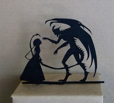 Your cake toppers can be tastefully dark: | 29 Reasons You Should Absolutely Have A Halloween Wedding