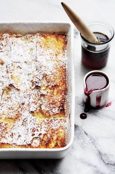 baked baguette french toast with blackberry sauce. Perfect for Brunch
