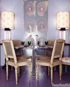 The muted hue beautifully picks up the silver furnishings in this intimate dining area.