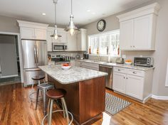 Traditional Kitchen with Hardwood floors, MS International Granite Blanco  Tulum, Flat panel cabinets, Kitchen island, Flush