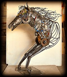 https://www.facebook.com/forja.madera?fref=ts  name Spectrum scrap metal art