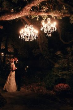 Southern wedding, love the chandeliers in the tree.