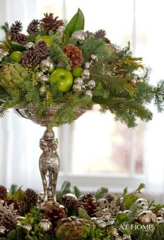 Christmas centerpieces by pine cones and apples by Decoholic