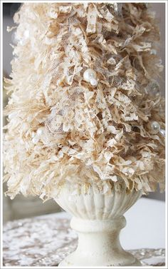 A lace-and-tulle ruffled tree!  Looks so vintage