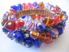 For your consideration a WOW vintage Cha Cha glass ball expandable bracelet. If you are looking for a fun piece that you will put on often..this is