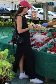 Farmers' market ready in a black cotton maxi, white sneakers and pink baseball cap.