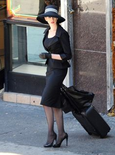 Selina Kyle steps out in this hot little black number.