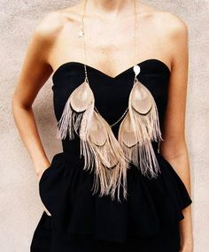 feather necklace.. DIY. So lovely, but the little man would wreck it in two seconds... someday. :)