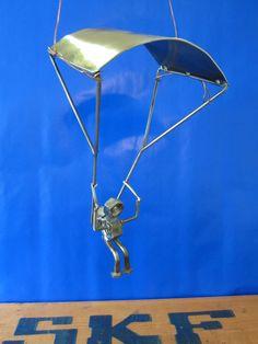SKY DIVING NUT metal sculpture.