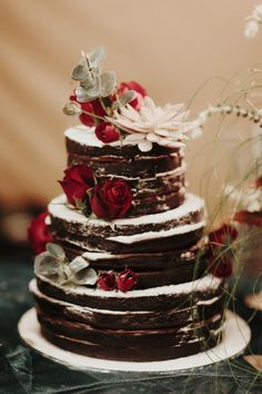 chocolate naked layer cake dressed with fresh flowers