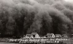 Dust storm rolling over a Kansas farm. 1935