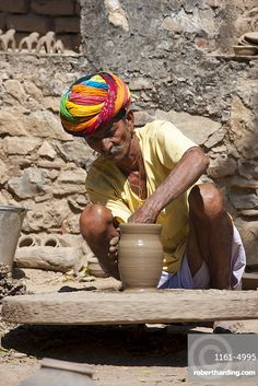 Indian potter in traditional Rajasthani turban works on potter's wheel at home making clay pots in Nimaj village, Rajasthan, Northern India Get premium, high resolution news photos at Getty Images Universal Studios Florida, Universal Orlando, Religions Du Monde, Cultures Du Monde, Village Photography, Indian Photography, Photography Poses, We Are The World, People Of The World