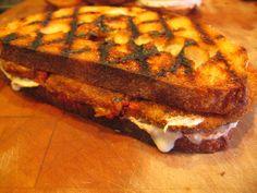 Grilled Eggplant Parmesan Sandwich  http://veganmenu.blogspot.com/2008/04/eggplant-parmesan-panini-grilled-white.html#