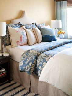 Colors of the Sea  In a sea of neutrals, sometimes the smallest details of color can make the largest impact and help carry a theme. Ocean-inspired throw pillows and a blue bedspread add a waterlike hue and pop against a backdrop of sand-color walls. The blue stripe in the rug picks up on the blue tones of the bedding and is reminiscent of a beach towel. Even the pointed headboard seems nautical.