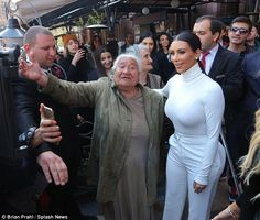 The moment she's been waiting for: Kim Kardashian's Queen-like status was confirmed on Sunday, when she accepted flowers from an elderly fan who had waited three days to meet her
